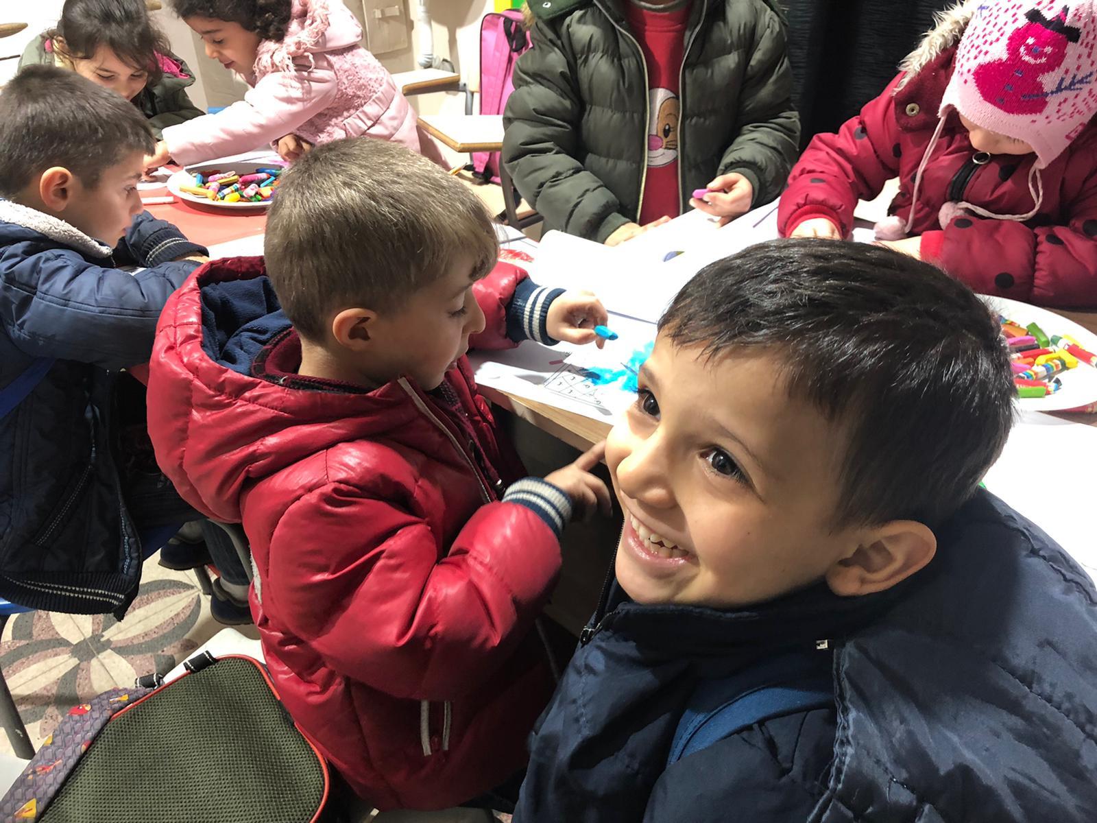Boy smiling in class